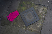 Detail of a pink-coloured glove on the pavement in a central London street, on 6th February 2018, in London, England.