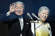Japanese Emperor Akihito (L) and Empress Michiko wave to well-wishers during a public appearance for New Year celebrations at the Imperial Palace in Tokyo, Japan, January 2, 2018. 02/01/2018-Tokyo, JAPAN