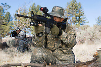 Soldier aiming machine gun