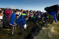 © licensed to London News Pictures. Okehampton, UK  14/05/2011 Thousands of young people scramble for the best position at the start of the 2011 Ten Tors event on Dartmoor today (Sat). Please see special instructions for usage rates. Photo credit should read London News Pictures