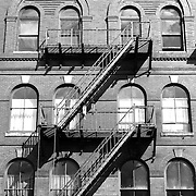 An old building complete with fire escapes in downtown Bangor, Maine, USA. Bangor is the 3rd largest city in the state and the retail, cultural and service center for central, eastern and northern Maine, as well as Atlantic Canada.