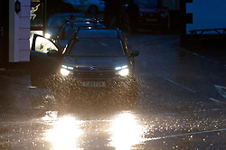 © Licensed to London News Pictures. 25/10/2019. Llanwrtyd Wells, Powys, Wales, UK. Motorists drive through surface water at Llanwrtyd Wells in Powys as heavy rainfall hits Powys, Wales, UK. Photo credit: Graham M. Lawrence/LNP