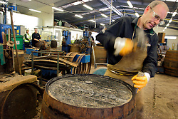 UK SCOTLAND DUFFTOWN 24JUN04 - Cooper Ian McDonald, who has worked at Glenfiddich 35 years (since he was 15) repairs an oak cask at the Glenfiddich cooperage in Dufftown, Scotland, the world's Whisky capital. Glenfiddich is the largest family-owned single malt Whisky destillery worldwide with 80% of production destined for export.....jre/Photo by Jiri Rezac for Frankfurter Allgemeine....© Jiri Rezac 2004....Contact: +44 (0) 7050 110 417..Mobile:  +44 (0) 7801 337 683..Office:  +44 (0) 20 8968 9635....Email:   jiri@jirirezac.com..Web:    www.jirirezac.com....© All images Jiri Rezac 2004 - All rights reserved.