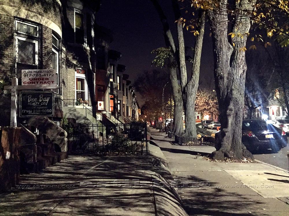 Street in Brooklyn at night.
