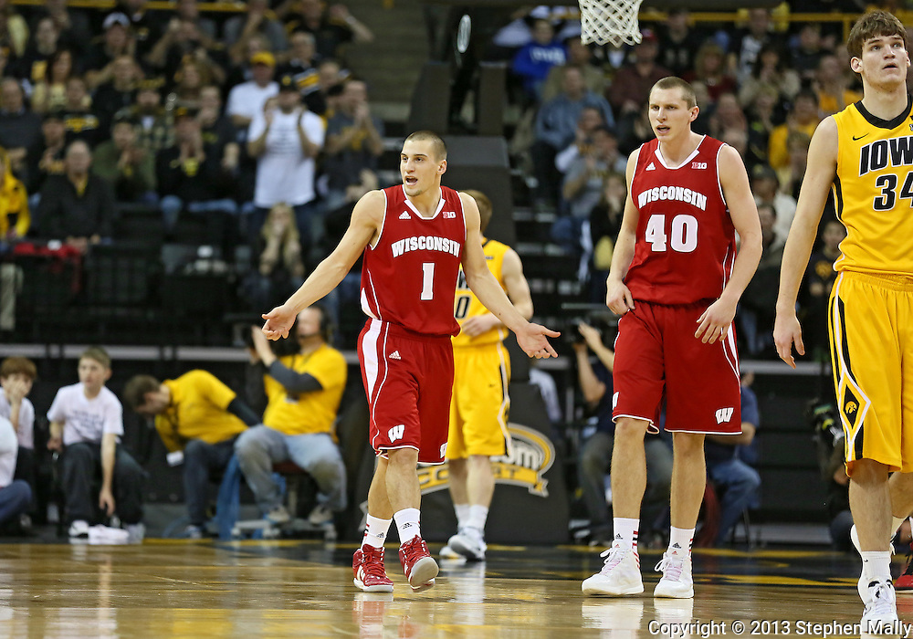 January 19 2013: Wisconsin Badgers guard Ben Brust (1) and Wisconsin Badgers forward/center Jared Berggren (40) question a call during the first half of the NCAA basketball game between the Wisconsin Badgers and the Iowa Hawkeyes at Carver-Hawkeye Arena in Iowa City, Iowa on Sautrday January 19 2013. Iowa defeated Wisconsin 70-66.