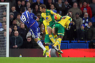 Gary O'Neil of Norwich and Youssouf Mulumbu of Norwich combine to block a shot on goal by Diego Costa of Chelsea during the Barclays Premier League match at Stamford Bridge, London<br /> Picture by Paul Chesterton/Focus Images Ltd +44 7904 640267<br /> 21/11/2015