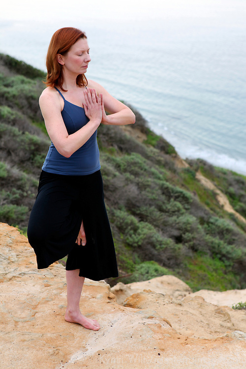 USA, California. Healthy woman in yoga pose outdoors.