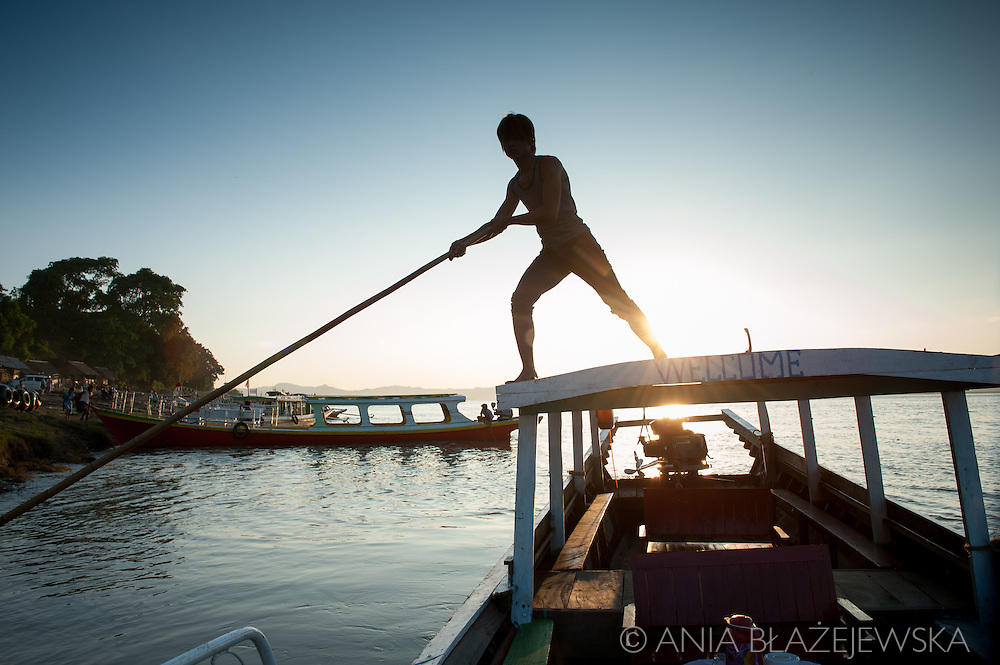 Myanmar, Bagan. Silhouette of a man who works on the boat on the Irrawaddy River.