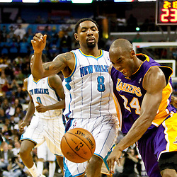 Dec 5, 2012; New Orleans, LA, USA; New Orleans Hornets shooting guard Roger Mason Jr. (8) fouls Los Angeles Lakers shooting guard Kobe Bryant (24) during the fourth quarter of a game at the New Orleans Arena. The Lakers defeated the Hornets 103-87.  Mandatory Credit: Derick E. Hingle-USA TODAY Sports
