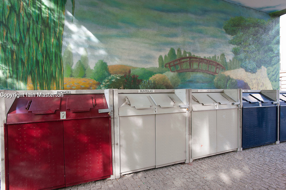 Domestic refuse containers colour coded for different types of waste outside apartment building in Berlin Germany