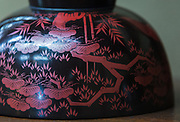 Photo shows a detail of a lacquerware bowl on display inside the Folk Art Museum, which is located in the grounds of the Toyama Folk Village in Toyama Prefecture Japan. The storehouse, which once housed a bath house for servants, was built in 1879 and moved to its current location in 1965.