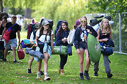 © Licensed to London News Pictures. 21/08/2019. Reading, UK. Revelers make their to Reading Festival on a sunny summers day. Warm weather is expected to greet the start of the three day music festival, twinned with Leeds Festival, which attract over 90,000 people over the bank holiday weekend. Photo credit: Ben Cawthra/LNP
