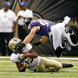 Aug 28, 2014; New Orleans, LA, USA; New Orleans Saints running back Travaris Cadet (39) is tackled by Baltimore Ravens linebacker John Simon (94) during the first half of a preseason game at Mercedes-Benz Superdome. Mandatory Credit: Derick E. Hingle-USA TODAY Sports