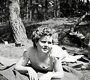 young adult woman laying in the woods 1950s Netherlands