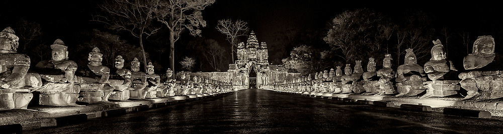 The South Gate of Angkor Thom along with Angkor Wat and Bayon Temple are lit up at night to celebrate Khmer New Year in Cambodia.