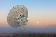 Fog, the full moon, and the Very Large Array (VLA). Southwestern New Mexico on the Plains of San Augustin.