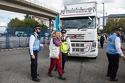 London, UK. 7 September, 2019. An activist stands in the road in front of a truck attempting to deliver to ExCel London during the sixth day of Stop The Arms Fair protests against DSEI, the world's largest arms fair. The sixth day of protests was billed as a Festival of Resistance and included performances, entertainment for children and workshops as well as activities intended to disrupt deliveries to ExCel London for the arms fair.