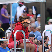 A on duty life guard watches the event from the side lines during the Summer Swim league championships finials Saturday, July. 17, 2015 at Western YMCA in Wilmington, DEL