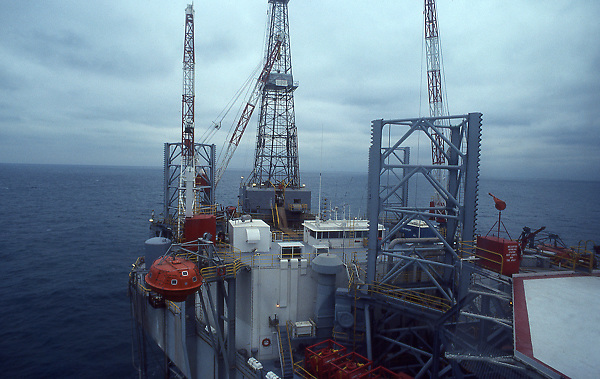 Stock photo onboard an offshore jack-up drilling rig with jack-up leg in foreground