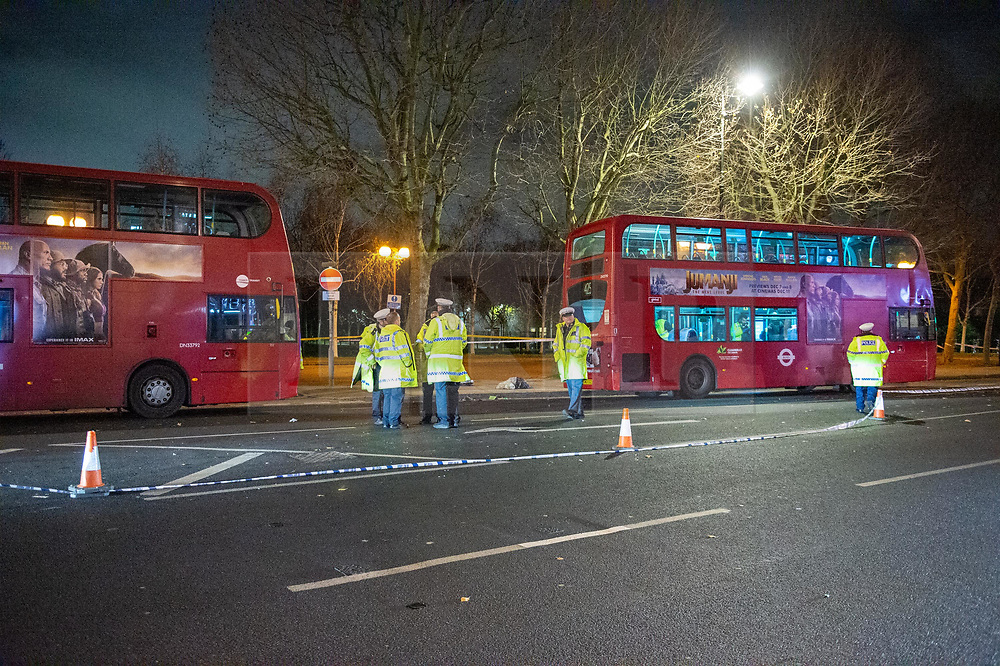 © Licensed to London News Pictures. 05/12/2019. London, UK. Police inspect a London bus on Grove Road after a pedestrian - a woman in her 50's - was involved in a collision near the junction of Mile End Road. The woman was taken to an East London hospital in a serious condition. Photo credit: Peter Manning/LNP