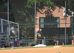 June 14, 2017 - Alexandria, Virgina, U.S. - Policemen work at the site of the gunshot at Eugene Simpson Stadium Park in Alexandria. Steve Scalise, a U.S. House Republican leader, was among possibly five people shot by a gunman Wednesday morning as he was playing baseball game with other congressmen and aides. The suspect who opened fire in the baseball game practice field in Alexandria, Virginia, was in custody, said Alexandria police.  zhf) (Credit Image: © Yin Bogu/Xinhua via ZUMA Wire)