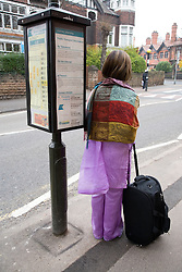 Woman waiting for bus at the bus stop,
