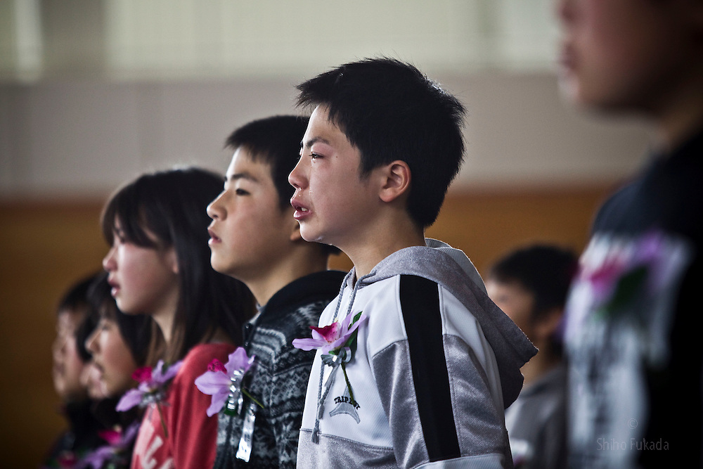 A student cries during Hashikami elementary school's graduation ceremony at an evacuation center in Kesennuma, Miyagi prefecture, Japan, March 22, 2011.