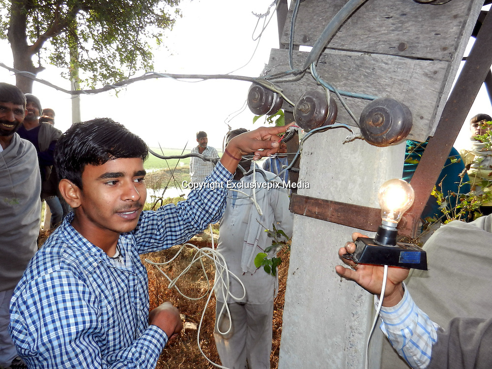I'm a human lightbulb! The 16-year-old 'electric boy' from India can withstand shocking 11,000 volts without feeling a thing <br /> <br /> It's enough to make your hair stand on end.<br /> An Indian teenager has told how he can withstand 11,000 volts passing through his body - and only discovered his bizarre talent by accident when he was repairing his mother's heater.<br /> Human electricity insulator Deepak Jangra can apparently resist the same amount of voltage required to power 500 houses and even sit with his hands inside a tub of water along with naked live wires.<br /> The 16-year-old claims: 'I have a gift from God. I feel very privileged. I have the power to do things no-one else can and I don't intend on wasting it.<br /> 'I used to be scared of electricity but now I am confident. I have tested myself over and over again and I will never get hurt. I can touch a live wire with my tongue and I know nothing will happen to me.' <br /> <br /> Deepak, who is a student, first discovered that he can resist such high levels of electricity three years ago when he was fixing his mother's portable heater.<br /> He revealed: 'My mother kept complaining that our heater was broken so I thought I'd take a look and try and fix it myself because we couldn't afford to take it anywhere and pay someone to fix it.<br /> 'I accidentally touched the live wire with my screwdriver but nothing happened - I didn't get a shock. But at the time I assumed we must have had a power failure in our village.'<br /> <br /> Two weeks later, Deepak got a movie stuck inside his DVD player and decided to take the machine apart to attempt to retrieve the disc.<br /> 'I hit the live wires again but again nothing happened,' he said. <br /> 'This time I knew something amazing had just happened. I touched it again and again, and then went outside to check the power supply was ok.<br /> 'That was the day I realised there was something unusual about me.'<br /> <br /> Since that moment, Deepak has been experimenting with various devices of different voltages - and he has