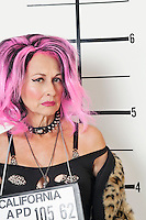 Mug shot of senior punk woman
