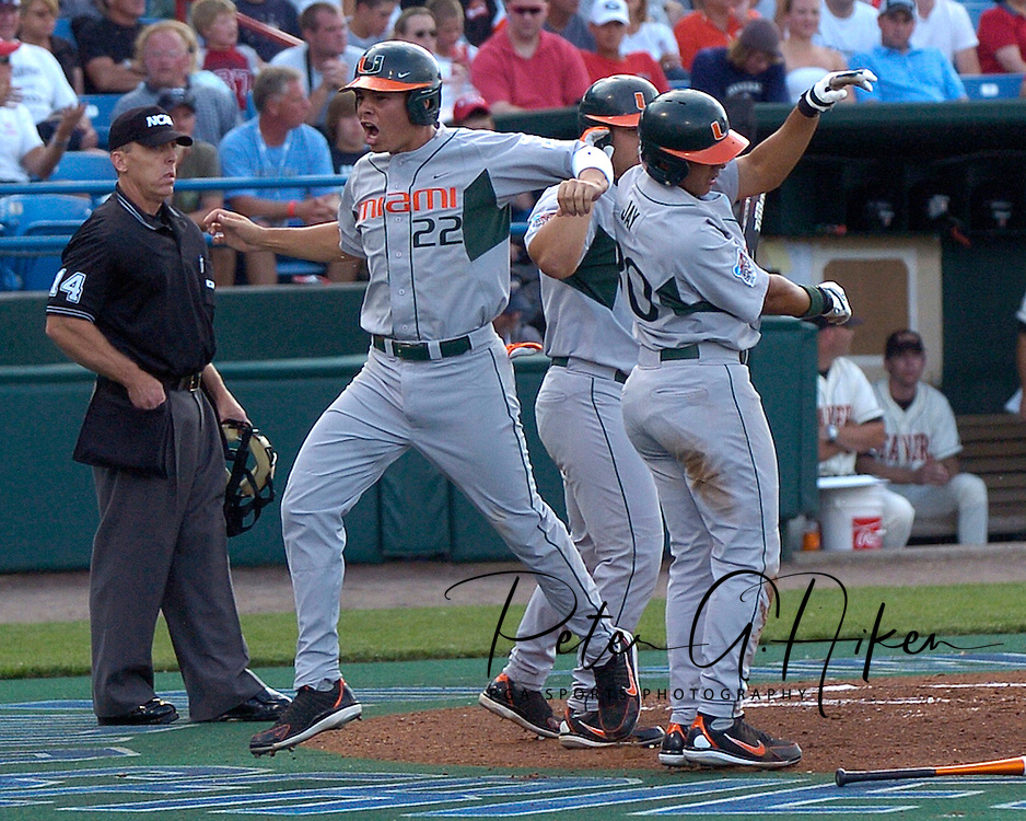 Miami's Danny Valencia (22) celebrates with teammate Jon Jay (30) after scoring in the first inning against Oregon State, during the College World Series at Rosenblatt Stadium in Omaha, Nebraska, June 17, 2006.