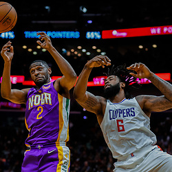 Jan 28, 2018; New Orleans, LA, USA; New Orleans Pelicans guard Ian Clark (2) and LA Clippers center DeAndre Jordan (6) battle for a rebound during the second quarter at the Smoothie King Center. Mandatory Credit: Derick E. Hingle-USA TODAY Sports