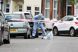 © Licensed to London News Pictures. 19/06/2019. London, UK. A forensic officer on Wellbeck Road, Barnet, North London where three men were found to be suffering stab injuries on Tuesday 18 June 2019, just before 11pm. A man in his 30s was treated at the scene, but he was pronounced dead shortly after midnight. Two other men – one in his 20s and one in his 30s were taken to hospital for treatment.  Photo credit: Dinendra Haria/LNP