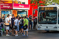 BUCHAREST, ROMANIA - September 29, 2012: People waiting the bus in downtown Bucharest.