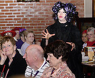 "Tamra Francis (standing) during Mayhem & Mystery's production of ""Costume Carousing"" at the Spaghetti Warehouse in downtown Dayton, Monday, September 12, 2011."