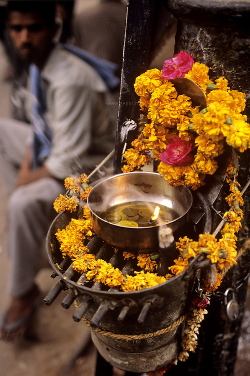 A black iron idol of the goddess Shani is taken out to the streets of Old Delhi on Saturday to collect money in the name of the deity, the patron of the day (Saturday is Shanivar in Hindi). Black colored items like sesame til, sesame oil, black clothes, and black gram whole are offered to Shani.