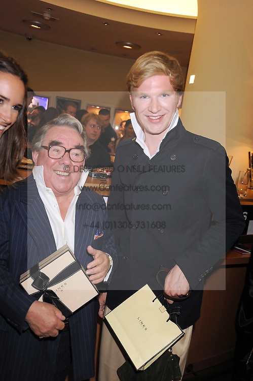 Left to right, RONNIE CORBETT and HENRY CONWAY at a party hosted by Links of London to launch their new Driver Chicane Chronograph Watch held at Lonks, Sloane Square, London on 24th September 2008.