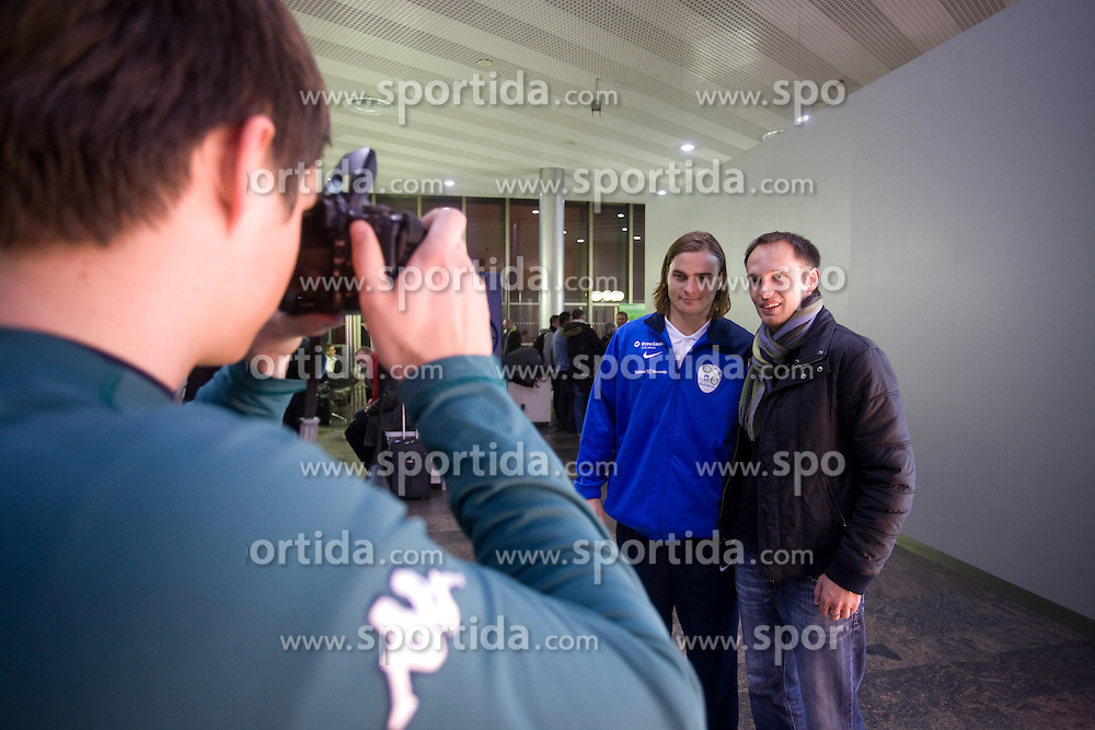 Nejc Pecnik with a fan at airport Shermetjevo after the FIFA World Cup South Africa 2010 Qualifying play-off match between Russia and Slovenia,  on November 14, 2009, in Moscow, Slovenia.   (Photo by Vid Ponikvar / Sportida)