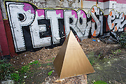 A pyramid with a message telling Malek that unknown people are sorry he's leaving, on wasteground in Camberwell,  London.