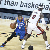 21 June 2012: Oklahoma City Thunder point guard Russell Westbrook (0) drive past Miami Heat small forward LeBron James (6) during the Miami Heat 121-106 victory over the Oklahoma City Thunder, in Game 5 of the 2012 NBA Finals, at the AmericanAirlinesArena, Miami, Florida, USA. The Miami Heat wins the series 4-1.