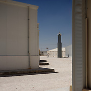 August 09, 2013 - Zarqa, Jordan: View of the minaret of the improvised mosque at the Mrigb Al-Fuhud refugee camp, also known as Emirates-Jordanian camp, 20 kilometres east of the Jordanian city of Zarqa.<br /> The 10 million USD camp, which has 750 caravans, a hospital, and a school and can take up to four thousand people, first opened in April 2013 and was paid for by the United Arab Emirates. Work is underway to house a total of 20 thousand by the end of the year.<br /> In contrast with the two other camps in the area, Mrigb Al-Fuhud as been classified by many as a 'five star' camp due to impressive housing facilities provided to the refugees. (Paulo Nunes dos Santos/Al Jazeera)