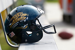 OAKLAND, CA - OCTOBER 21: Detailed view of a Jacksonville Jaguars football helmet on the bench before the game against the Oakland Raiders at O.co Coliseum on October 21, 2012 in Oakland, California. The Oakland Raiders defeated the Jacksonville Jaguars 26-23 in overtime. Photo by Jason O. Watson/Getty Images) *** Local Caption ***