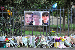 © Licensed to London News Pictures. 29/01/2018. London, UK.  Photographs hang on railings above floral tributes. George Wilkinson, 16, Harry Rice, 17, and Josh Mcgunnies, 16, were killed when a car mounted the pavement in Hayes, west London, on the night of 27 January. Jaynesh Chudasama, 28, of Hayes has been charged with three counts of causing death by dangerous driving and will appear in custody at Uxbridge Magistrates Court on Monday 29 January.  Photo credit: Stephen Chung/LNP