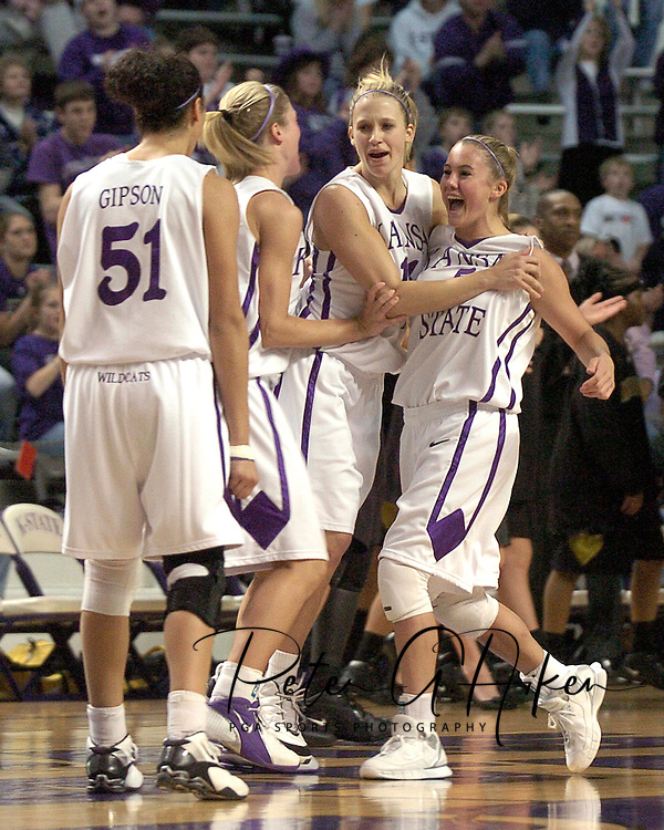 Kansas State's (R-L) Shalee Lehning, Claire Coggins, Danielle Zanotti and Marlies Gipson celebrate as the Wildcats take a quick 6-0 lead over Missouri in the opening moments of the first half.  Missouri defeated K-State 66-65 in overtime at Bramlage Coliseum in Manhattan, Kansas, February 1, 2006.