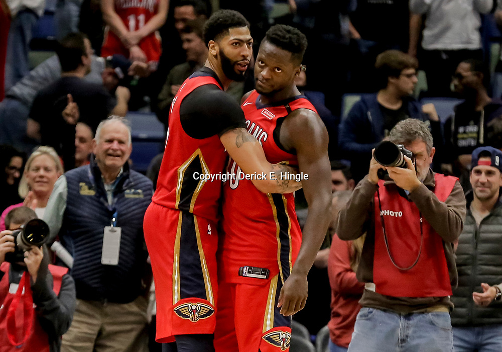 Dec 12, 2018; New Orleans, LA, USA; New Orleans Pelicans forward Anthony Davis (23) hugs forward Julius Randle (30) following a win against the Oklahoma City Thunder at the Smoothie King Center. Mandatory Credit: Derick E. Hingle-USA TODAY Sports