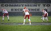 """Kansas City Chiefs strong safety Eric Berry (29) looks on in a driving rain with the Oakland Raiders """"commitment to excellence"""" sign in the background during the NFL week 12 regular season football game against the Oakland Raiders on Thursday, Nov. 20, 2014 in Oakland, Calif. The Raiders won their first game of the season 24-20. ©Paul Anthony Spinelli"""