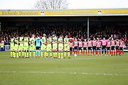 Both Lincoln City and Exeter City line up and pay tribute to the deceased Red Arrows Flight Engineer who died during training flight prior to the EFL Sky Bet League 2 match between Lincoln City and Exeter City at Sincil Bank, Lincoln, United Kingdom on 30 March 2018. Picture by Mick Atkins.