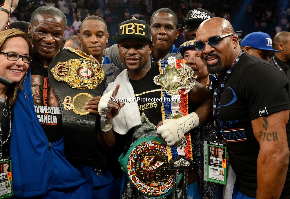 Floyd Mayweather, Jr. (USA), <br /> SEPTEMBER 14, 2013 - Boxing :<br /> Floyd Mayweather, Jr. of the United States celebrates with his champion belts after winning the WBC and WBA Super Welterweight titles bout at MGM Grand Garden Arena in Las Vegas, Nevada, United States. (Photo by Naoki Fukuda/AFLO)914MGM WBA  Floyd Mayweather 2-0 WBC  &quot;&quot; Saul &quot;Canelo&quot; Alvarez