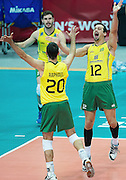 Brazil's Bruno Mossa Rezende (left, up) Oliveira Raphael De Vieira and Luiz Felipe Marques  Fonteles  celebrate after winnig the match between France and Brazil during the 2014 FIVB Volleyball World Championships at Spodek in Katowice on September 20, 2014.