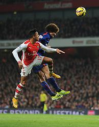 Manchester United's Marouane Fellaini wins a high ball from Arsenal's Alexis Sanchez - Photo mandatory by-line: Alex James/JMP - Mobile: 07966 386802 - 22/11/2014 - Sport - Football - London - Emirates Stadium - Arsenal v Manchester United - Barclays Premier League