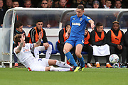 Luton Town defender Glen Rea (16) with a two foted tackle on AFC Wimbledon midfielder Anthony Hartigan (8) during the EFL Sky Bet League 1 match between AFC Wimbledon and Luton Town at the Cherry Red Records Stadium, Kingston, England on 27 October 2018.